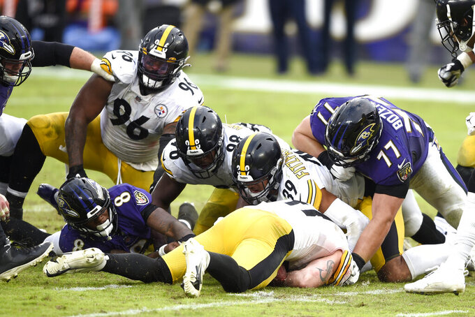 Pittsburgh Steelers linebacker Robert Spillane, bottom center, recovers a fumble by Baltimore Ravens quarterback Lamar Jackson (8) during the second half of an NFL football game, Sunday, Nov. 1, 2020, in Baltimore. The Steelers won 28-24. (AP Photo/Gail Burton)