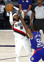 Portland Trail Blazers forward Carmelo Anthony (00) looks to shoot over LA Clippers forward Patrick Patterson (54) during the second half in an NBA basketball Saturday, Aug. 8, 2020, in Lake Buena Vista, Fla. (Kim Klement/Pool Photo via AP)