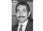 Wyandotte County (Kan.) District Court Judge Carlos Murguia, is seen in an undated black and white photo. The House Judiciary Committee questioned the adequacy of the protections against workplace harassment and misconduct in the judicial branch after a federal judge in Kansas was publicly reprimanded for sexually harassing female employees and having an extramarital affair with an offender. The Judicial Council for the 10th U.S. Circuit admonished U.S. District Judge Carlos Murguia last September for subjecting employees to sexually suggestive comments, inappropriate text messages and non-work contact. (AP Photo/The Kansas City Star via AP)