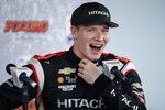 File-This Aug. 17, 2019, file photo shows Josef Newgarden laughing during a news conference for Sunday's IndyCar Series auto race at Pocono Raceway, in Long Pond, Pa. Newgarden has been the IndyCar points leader for all but one race this season and built enough of a cushion that his mindset has changed as the championship race speeds into an anticlimactic final two events of the year. (AP Photo/Matt Slocum, File)