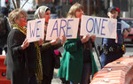 Supporters of the mosque shooting survivors hold signs of support outside the Christchurch High Court after the sentencing hearing for Australian Brenton Harrison Tarrant, in Christchurch, New Zealand, Thursday, Aug. 27, 2020. Tarrant, a white supremacist who killed 51 worshippers at two New Zealand mosques in March 2019 was sentenced to life in prison without the possibility of parole. (AP Photo/Mark Baker)