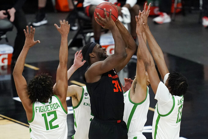 Oregon State's Rodrigue Andela (34) shoots against Oregon during the second half of an NCAA college basketball game in the semifinal round of the Pac-12 men's tournament Friday, March 12, 2021, in Las Vegas. (AP Photo/John Locher)