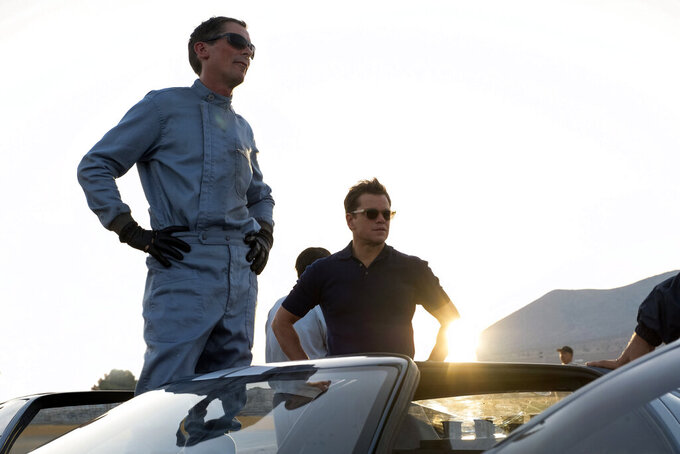 "This image released by 20th Century fox shows Christian Bale, left, and Matt Damon in a scene from ""Ford v. Ferrari,"" in theaters on Nov. 15. (Merrick Morton/20th Century Fox via AP)"