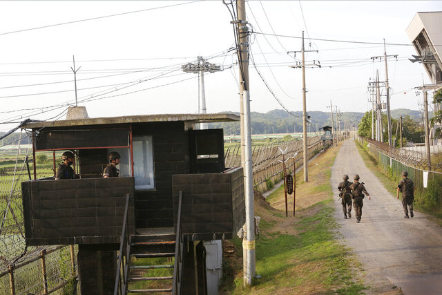 FILE - In this June 15, 2020, file photo, South Korean army soldiers patrol along the barbed-wire fence in Paju, South Korea, near the border with North Korea. A North Korean diplomat who served as the country's acting ambassador to Kuwait has defected to South Korea, according to South Korean lawmakers who were briefed by Seoul's spy agency on Tuesday, Jan. 26, 2021. (AP Photo/Ahn Young-joon, File)