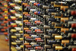 FILE - In this June 16, 2016, file photo, bottles of wine are displayed during a tour of a state liquor store, in Salt Lake City. The tariffs the Trump administration is about to impose on wine, liquor and cheese from Europe couldn't come at a worse time for small retailers. (AP Photo/Rick Bowmer, File)