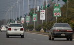 Pakistani riders drive past posters welcoming Saudi Arabia's Crown Prince Mohammed bin Salman displayed on the occasion of the visit by Saudi Arabia's crown prince to Pakistan, in Islamabad, Pakistan, Sunday, Feb. 17, 2019. Saudi Crown Prince Mohammed bin Salman will arrive in Islamabad on Sunday evening on an official visit that is expected to include the signing of agreements for billions of dollars of investment in Pakistan. (AP Photo/Anjum Naveed)