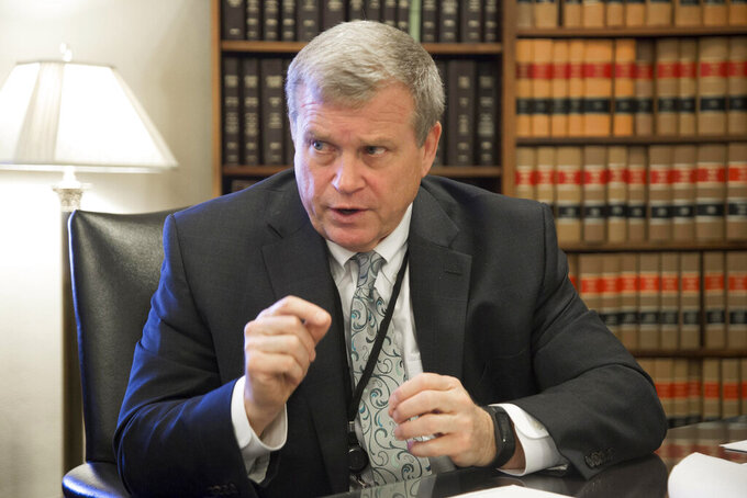 FILE - This March 1, 2017 file photo shows Idaho Attorney General Lawrence Wasden during an interview in Boise, Idaho. GOP Idaho lawmakers frustrated with the Republican Idaho attorney general have put forward a series of bills that could significantly defund his office. Wasden irked lawmakers by not joining a Texas lawsuit to invalidate the presidential election. (Darin Oswald/Idaho Statesman via AP, File)