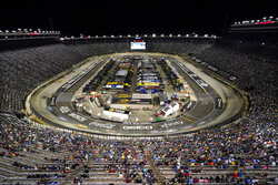 Fans watch a NASCAR Cup Series auto race at Bristol Motor Speedway Saturday, Sept. 18, 2021, in Bristol, Tenn. (AP Photo/Mark Humphrey)