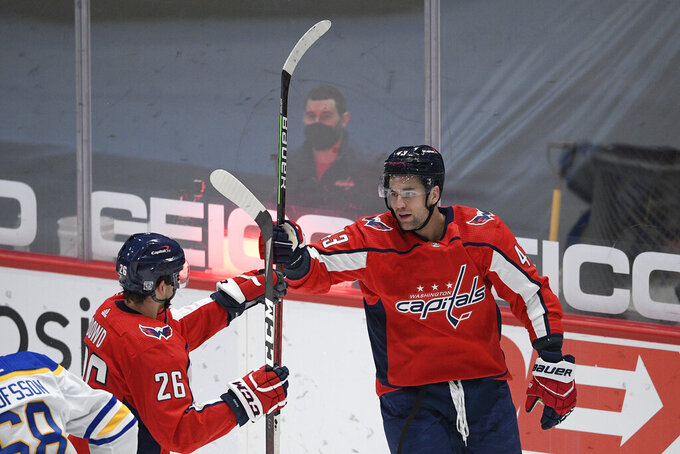 Washington Capitals right wing Tom Wilson (43) celebrates his goal with center Nic Dowd (26) during the second period of an NHL hockey game against the Buffalo Sabres, Thursday, Feb. 18, 2021, in Washington. (AP Photo/Nick Wass)