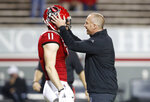 North Carolina State head coach Dave Doeren, right, talks with linebacker Payton Wilson (11) before an NCAA college football game against Liberty in Raleigh, N.C., Saturday, Nov. 21, 2020. (Ethan Hyman/The News & Observer via AP, Pool)