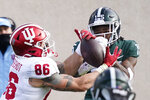 Indiana tight end Peyton Hendershot (86), defended by Michigan State cornerback Angelo Grose makes a catch during the first half of an NCAA college football game, Saturday, Nov. 14, 2020, in East Lansing, Mich. (AP Photo/Carlos Osorio)
