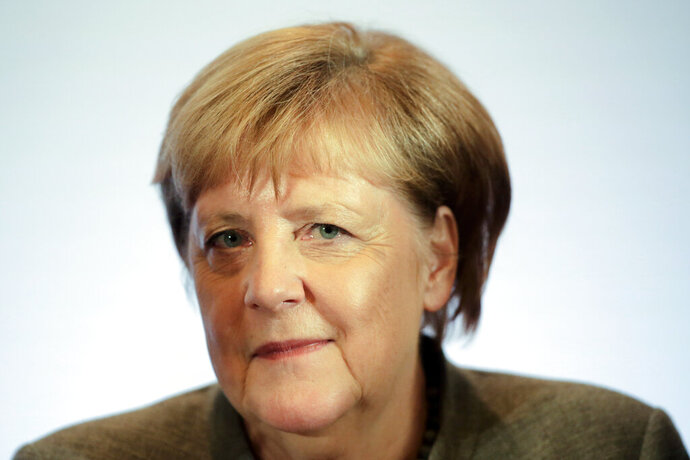 German Chancellor Angela Merkel attends a Christian Social Union party (CDU) board meeting at the eve of a party convention in Leipzig, Thursday, Nov. 21, 2019. (AP Photo/Markus Schreiber)
