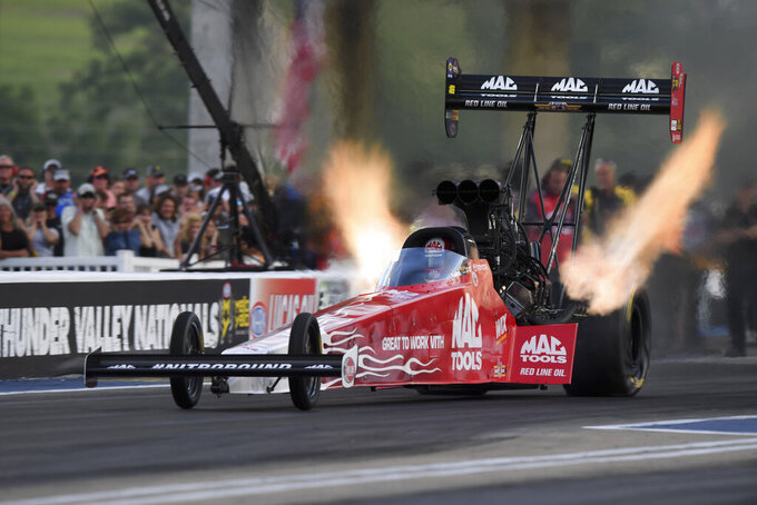 In this photo provided by the NHRA, Doug Kalitta drives in Top Fuel qualifying Friday, June 14, 2019, at the NHRA Thunder Valley Nationals drag races at Bristol Dragway in Bristol, Tenn. (Jerry Foss/NHRA via AP)