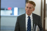 FILE - Sen. James Lankford, R-Okla., arrives for a hearing on Capitol Hill, Tuesday, June 8, 2021, in Washington. Lankford,  whose voting record in the Senate has aligned with former President Donald Trump's position nearly 90% of the time, finds himself under fierce attack by a challenger in his own party. Similar scenes are playing out in other red states where ultra right-wing challengers are tapping into anger among Republicans over Trump's election loss and coronavirus-related lockdowns. (AP Photo/Alex Brandon)