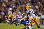 LSU safety Grant Delpit (7) breaks up a pass intended for Florida wide receiver Freddie Swain (16) as cornerback Kary Vincent Jr. (5) defends in the first half of an NCAA college football game in Baton Rouge, La., Saturday, Oct. 12, 2019. (AP Photo/Gerald Herbert)