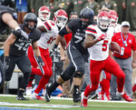 Stony Brook punt returner Donavin Washington, right, runs for a long gain past Air Force special team members Griffin Landrum, center, and Kyle Johnson in the first half of an NCAA college football game Saturday, Sept. 1, 2018, at Air Force Academy, Colo. (AP Photo/David Zalubowski)