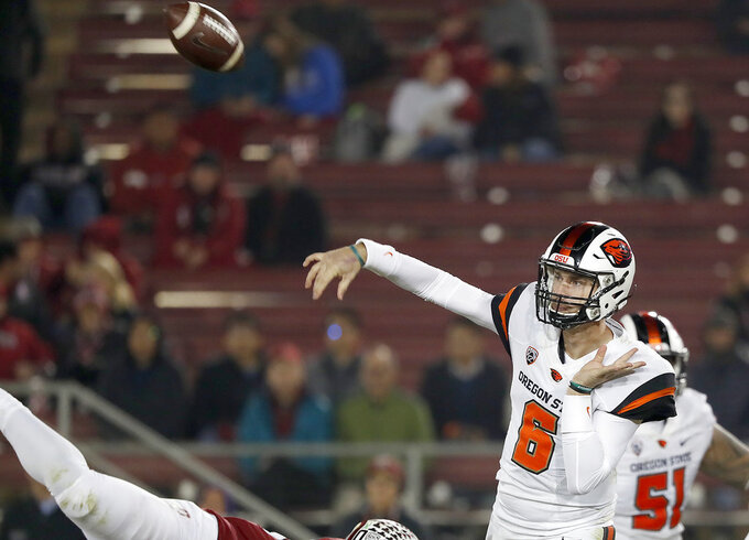 Oregon State quarterback Jake Luton (6) throws a pass against Stanford in the second half during an NCAA college football game on Saturday, Nov. 10, 2018, in Stanford, Calif. Stanford won 48-17. (AP Photo/Tony Avelar)