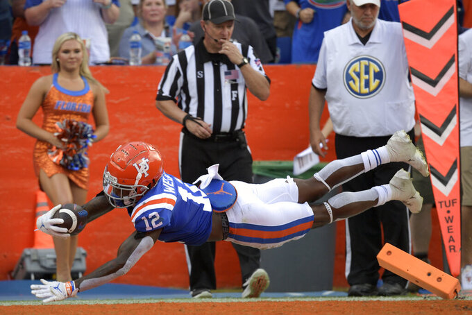 Florida wide receiver Rick Wells (12) dives into the end zone after catching a pass but is ruled out-of-bounds before crossing the goal line during the second half of an NCAA college football game against Vanderbilt, Saturday, Oct. 9, 2021, in Gainesville, Fla. (AP Photo/Phelan M. Ebenhack)