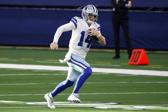 Dallas Cowboys quarterback Andy Dalton (14) keeps the ball for a gain in the first half of an NFL football game against the Philadelphia Eagles in Arlington, Texas, Sunday, Dec. 27. 2020. (AP Photo/Ron Jenkins)