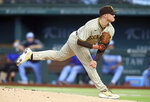 San Diego Padres starting pitcher Adrian Morejon delivers a pitch against the Texas Rangers in the first inning during a baseball game on Sunday, April 11, 2021, in Arlington, Texas. (AP Photo/Richard W. Rodriguez)
