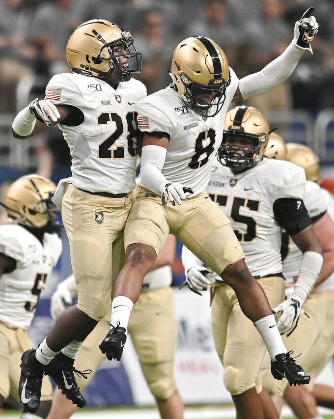 Army's Javhari Bourdeau (8) and Jabari Moore celebrate a forced UTSA turnover during the second half of an NCAA college football game Saturday, Sept. 14, 2019, in San Antonio. (AP Photo/Darren Abate)