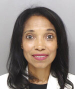 This booking photo released by the Hamilton County Jail shows former juvenile court judge Tracie Hunter. Hamilton County Common Pleas Judge Patrick Dinkelacker ordered Hunter's six-month jail sentence to be carried out on Monday, July 22, 2019, after a contentious hearing. Hunter, 52, had gone to multiple courts to challenge her 2014 conviction and sentence on a felony count of unlawful interest in a public contract.  (Hamilton County Jail via AP)