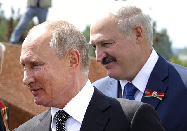 FILE - In this file photo taken on Tuesday, June 30, 2020, Russian President Vladimir Putin, left, and Belarusian President Alexander Lukashenko greet WWII veterans during an opening ceremony of the monument in honour of the World War II Red Army, in the village of Khoroshevo, just outside Rzhev, about 200 kilometers (about 125 miles) northwest of Moscow, Russia. President Alexander Lukashenko is seeking a sixth term in the Aug. 9 election but he has accused Russian forces of interfering with the upcoming vote, although Moscow has denied any involvement. (Mikhail Klimentyev, Sputnik, Kremlin Pool Photo via AP, File)