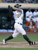 Oakland Athletics' Beau Taylor watches his solo home run against the Baltimore Orioles during the third inning of a baseball game in Oakland, Calif., Tuesday, June 18, 2019. (AP Photo/Jeff Chiu)