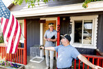 Volunteer firefighter John Hunter, right, describes losing his home and hardware store to the Dixie Fire, Sunday, Sept. 5, 2021, in Quincy, Calif. At left is EmergencyRV.org founder Woody Faircloth, who helped Hunter receive a donated RV. (AP Photo/Noah Berger)