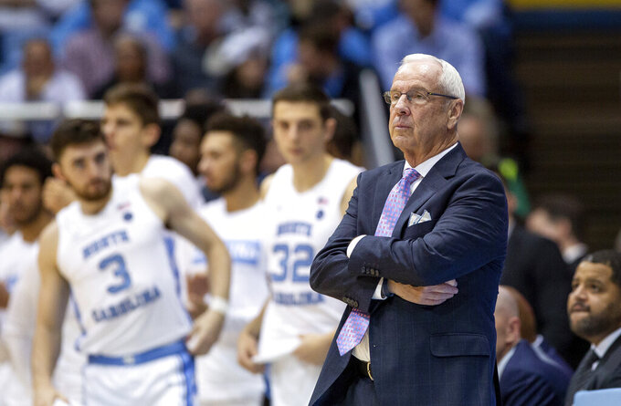 North Carolina Head Coach Roy Williams looks towards the court during the first half of an NCAA college basketball game against Elon in Chapel Hill, N.C., Wednesday, Nov. 20, 2019. (AP Photo/Ben McKeown)