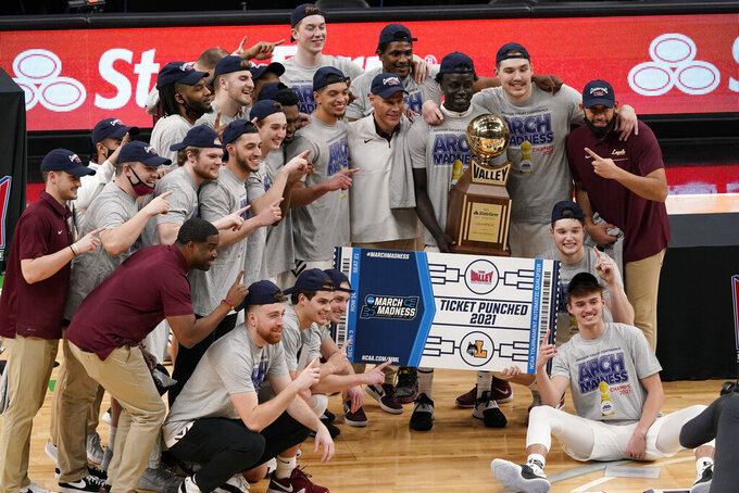 Members of Loyola of Chicago celebrate a 75-65 victory over Drake in the championship game of the NCAA Missouri Valley Conference men's basketball tournament Sunday, March 7, 2021, in St. Louis. (AP Photo/Jeff Roberson)