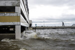 Storm surge from Hurricane Sally overtakes the outside parking lot and the first floor of the Palace casino parking garage in Biloxi, Miss., on Tuesday, Sept. 15, 2020.  The slow moving hurricane is driving a developing tidal surge and rains to a number of communities along the gulf coast. (Lukas Flippo/The Sun Herald via AP)