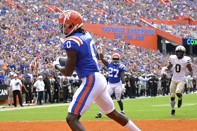 Florida wide receiver Ja'Quavion Fraziars (0) catches a pass in the end zone for a 5-yard touchdown receptions during the first half of an NCAA college football game against Vanderbilt, Saturday, Oct. 9, 2021, in Gainesville, Fla. (AP Photo/Phelan M. Ebenhack)