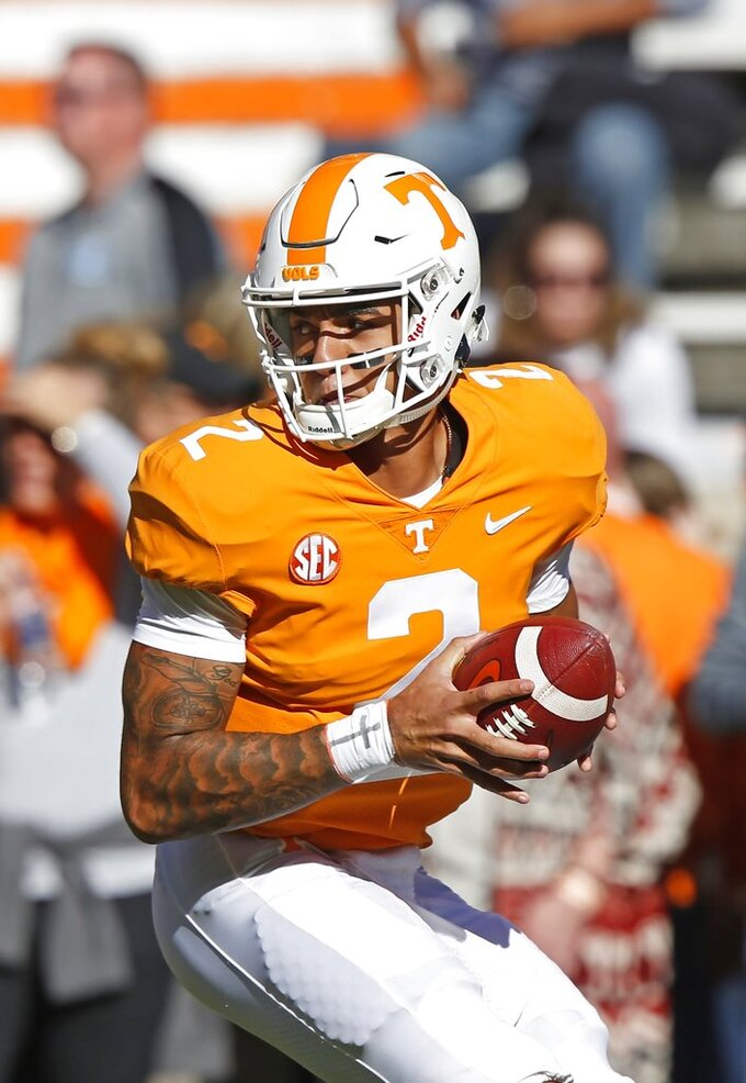 Tennessee quarterback Jarrett Guarantano (2) turns to hand the ball off before an NCAA college football game against Charlotte, Saturday, Nov. 3, 2018, in Knoxville, Tenn. (AP Photo/Wade Payne)