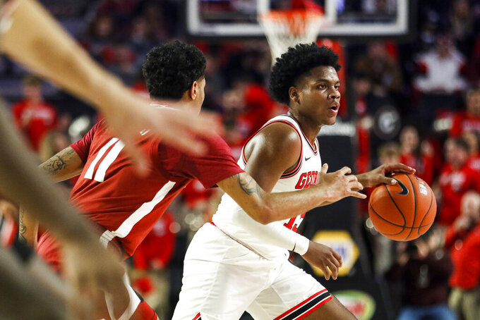 Georgia's Sahvir Wheeler (15) controls the ball during an NCAA basketball game against Alabama during an NCAA college basketball game Saturday, Feb. 8, 2020, in Athens, Ga. (Kristin M. Bradshaw/Athens Banner-Herald via AP)
