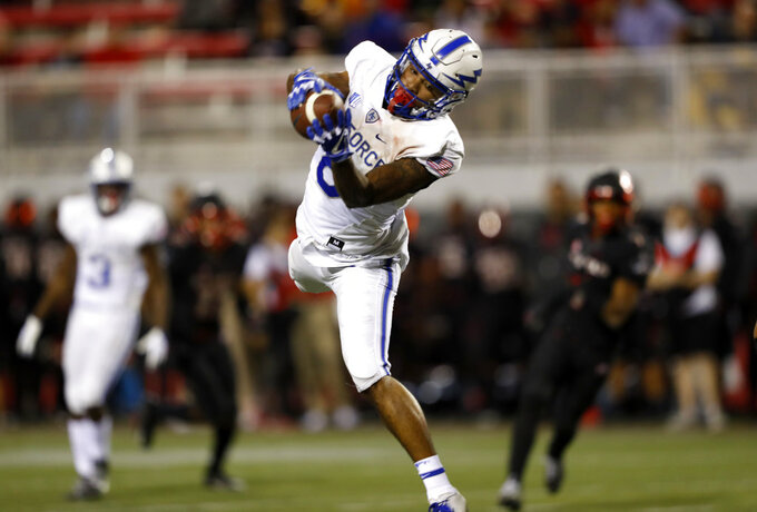 Air Force wide receiver Marcus Bennett (8) jumps for a pass reception against UNLV during the first half of an NCAA college football game in Las Vegas, Friday, Oct. 19, 2018. (Steve Marcus/Las Vegas Sun via AP)