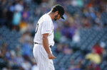 Colorado Rockies relief pitcher Joe Harvey reacts after walking New York Mets' Pete Alonso with the bases loaded to orce in the go-ahead run in the ninth inning of a baseball game Wednesday, Sept. 18, 2019, in Denver. The Mets won 7-4. (AP Photo/David Zalubowski)