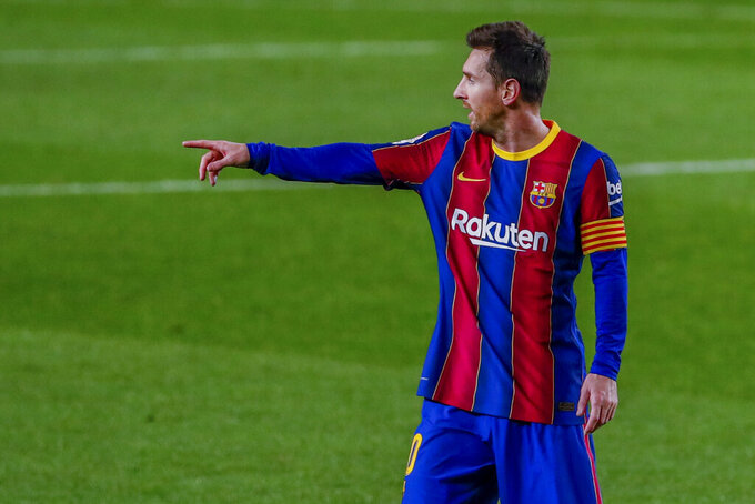 Barcelona's Lionel Messi gestures during the Spanish La Liga soccer match between FC Barcelona and Real Sociedad at the Camp Nou stadium in Barcelona, Spain, Wednesday, Dec. 16, 2020. (AP Photo/Joan Monfort)