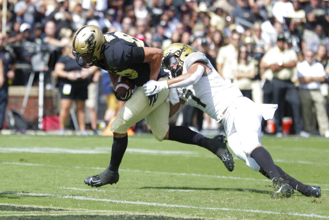 Purdue tight end Brycen Hopkins (89) runs in for a touchdown as he's hit by Vanderbilt linebacker Dimitri Moore (7) during the first half of an NCAA college football game in West Lafayette, Ind., Saturday, Sept. 7, 2019. (AP Photo/Michael Conroy)
