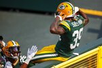 Green Bay Packers' Chandon Sullivan celebrates his interception and touchdown return during the second half of an NFL football game against the Detroit Lions Sunday, Sept. 20, 2020, in Green Bay, Wis. (AP Photo/Matt Ludtke)