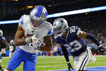 Detroit Lions wide receiver Marvin Jones (11), defended by Dallas Cowboys defensive back Darian Thompson (23), catches an 11-yard pass for a touchdown during the second half of an NFL football game, Sunday, Nov. 17, 2019, in Detroit. (AP Photo/Paul Sancya)