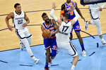 New York Knicks forward Reggie Bullock handles the ball against Memphis Grizzlies center Jonas Valanciunas (17) in the second half of an NBA basketball game Monday, May 3, 2021, in Memphis, Tenn. (AP Photo/Brandon Dill)