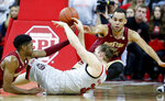 North Carolina State's Wyatt Walker (33) passes out of the pressure by Boston College's Wynston Tabbs, left, and Jordan Chatman during the first half of an NCAA college basketball game in Raleigh, N.C., Wednesday, Feb. 20, 2019. (Ethan Hyman/The News & Observer via AP)