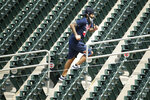 Minnesota Twins' Sergio Romo runs up steps in the ballpark at a baseball camp Friday, July 3, 2020, in Minneapolis. (AP Photo/Bruce Kluckhohn)