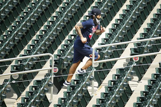 Minnesota Twins' Sergio Romo runs up steps in the ballpark at a baseball camp Friday, July 3, 2020, in Minneapolis. (AP Photo/Bruce Kluckhohn)