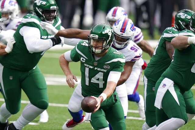 New York Jets quarterback Sam Darnold (14) looks to hand off during the first half of an NFL football game against the Buffalo Bills, Sunday, Oct. 25, 2020, in East Rutherford, N.J. (AP Photo/Frank Franklin II)