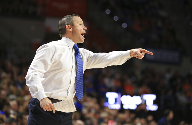 Florida head coach Mike White points during the first half of an NCAA college basketball game against Auburn, Saturday, Jan. 18, 2020, in Gainesville, Fla. (AP Photo/Matt Stamey)