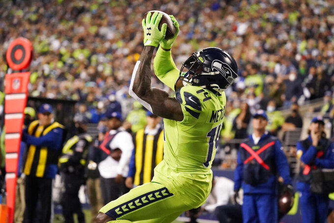 Seattle Seahawks wide receiver DK Metcalf catches a pass from backup quarterback Geno Smith for a touchdown against the Los Angeles Rams during the second half of an NFL football game, Thursday, Oct. 7, 2021, in Seattle. (AP Photo/Elaine Thompson)