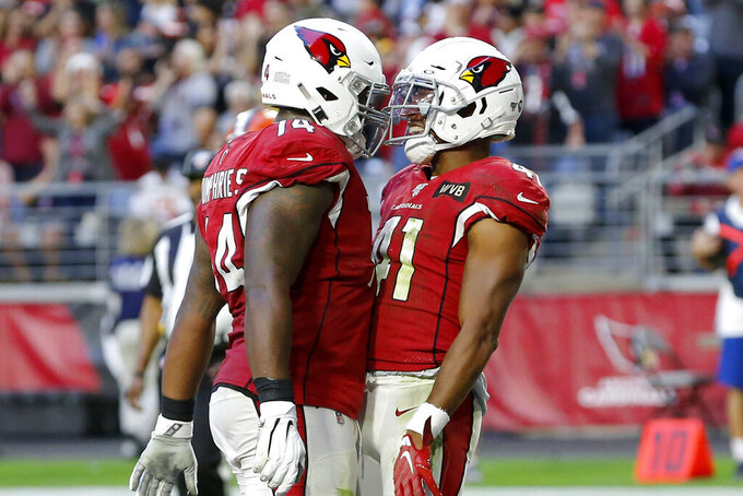 Arizona Cardinals running back Kenyan Drake (41) celebrates his third touchdown of the game with offensive tackle D.J. Humphries (74) during the second half of an NFL football game against the Cleveland Browns, Sunday, Dec. 15, 2019, in Glendale, Ariz. (AP Photo/Rick Scuteri)