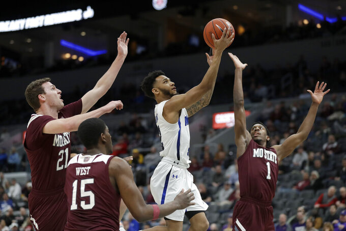 Indiana State's Jordan Barnes heads to the basket as Missouri State's Ross Owens (21), Lamont West (15) and Keandre Cook (1) defend during the first half of an NCAA college basketball game in the quarterfinal round of the Missouri Valley Conference men's tournament Friday, March 6, 2020, in St. Louis. (AP Photo/Jeff Roberson)